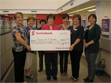 Valerie Comeau and her Scotiabank staff presenting a cheque for $1200 to Barbara Stothart, president of the Rotary Club of Newcastle.  Scotiabank employees sold 1/2 and 1/2 tickets at Rotary Springfest and raised $600.  With Scotiabank's Team Community Matching Program they were able to double that and donate $1200 to the Rotary Club.