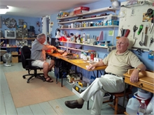John Cooper and Joe Allen, members of the Miramichi Area Model Railroad Society, in their workshop on the 2nd floor of the Seaman's Hospital.