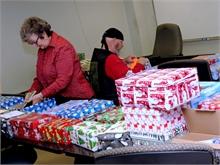 Elaine Dickson & Vet. Reg Pollock prepare shoeboxes for shipping.