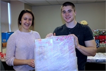 Alyssa Dickinson and Ryley Larsen on parcel wrap duty.